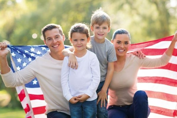 A family holds up a US flag