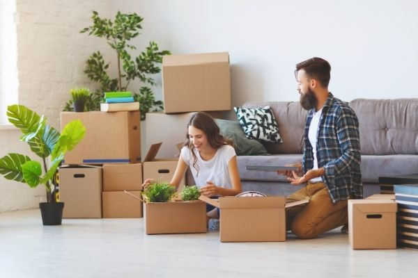 Couple in the middle of moving boxes